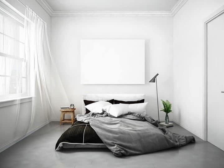 Chambre epuree grise et blanche