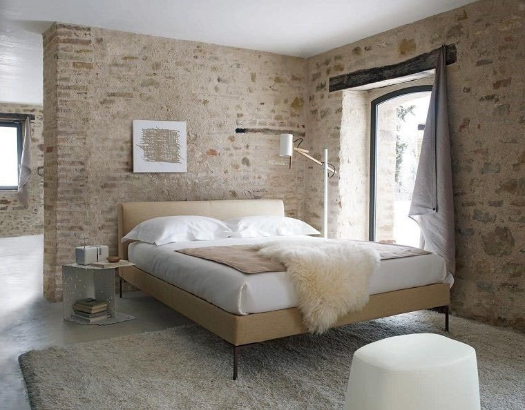 Chambre murs briques